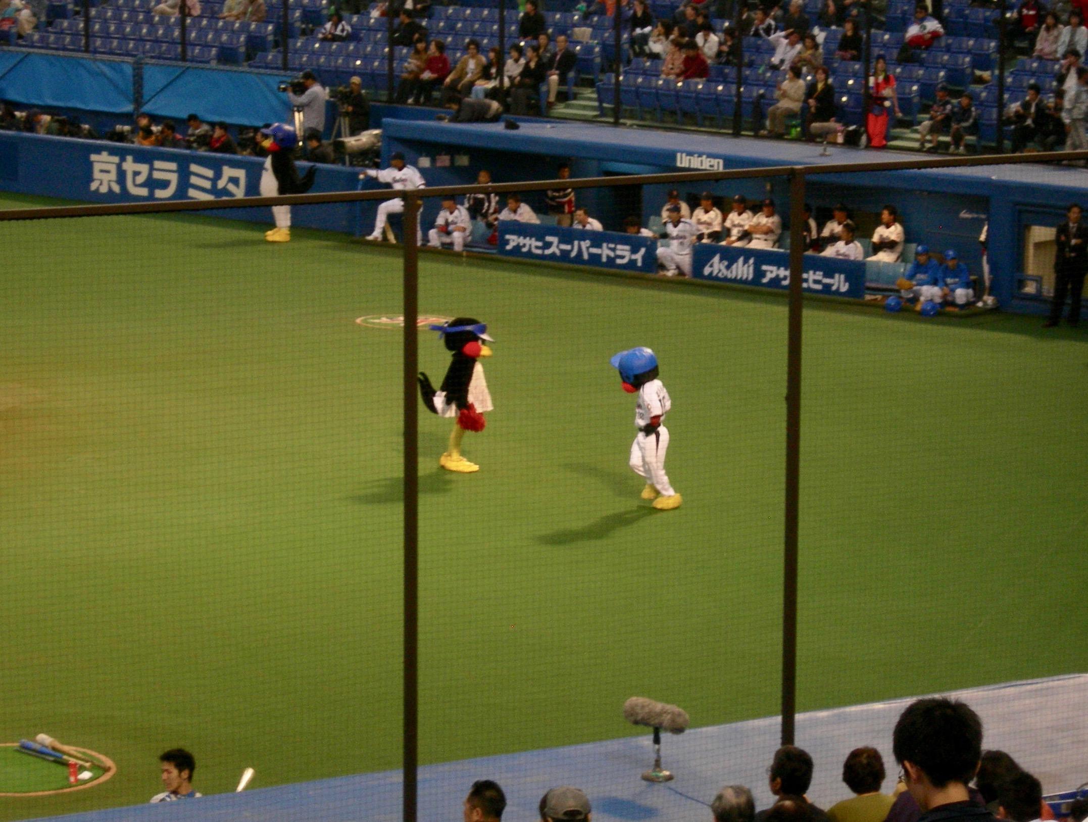 Swallow And Lion Mascots At Tokyo Swallows Baseball Game Tokyo Japan